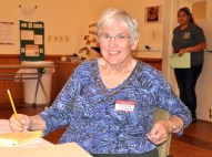 Judith Scruggs of the League of Women Voters and RATIFY ERA-NC registered conference participants.