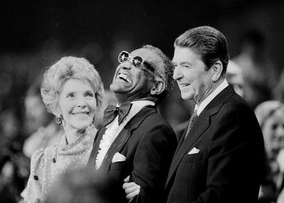 Music legend Ray Charles, center, laughs as President Reagan and Nancy Reagan joined him at a salute to country music at Constitution Hall in Washington, D.C., on March 16, 1983. Charles died Thursday, June 10, 2004, a spokesman said. He was 73. (AP Photo/Ira Schwarz)