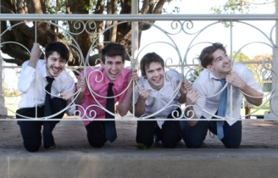 Photo of cast. Alex Simpson (Biron), Robert Lewis (The King of Navarre), Adam Hall (Dumaine) and Liam Walsh (Longaville)