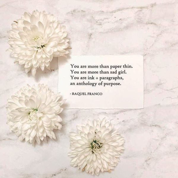 white flowers on paper with text of poem