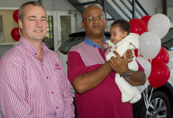 Sean Smith (Managing Director) of Kia Hermanus with Steven Lakay and his tot