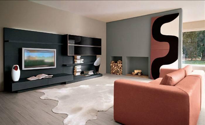 Modernes Wohnzimmer Mit Einem Eleganten Elektrokamin Ein Beispiel Fur Moderne Wohnzimmer Mit Schwarzer Tv Wand Und Behaglichem Designfu Boden