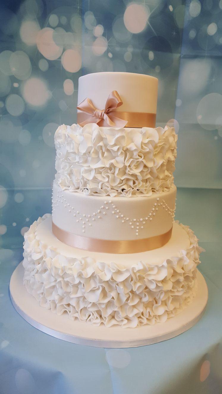 4 Tier Wedding cake  Ruffles  Ravens Bakery of Essex Ltd