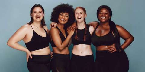 """What's My Body Type?"" A group of women with different body types in workout clothes."