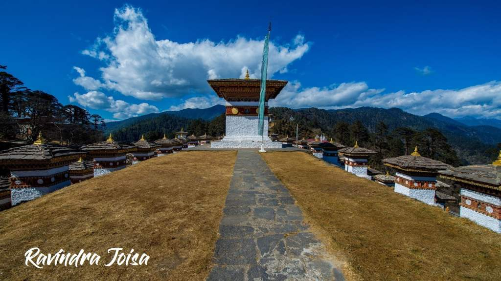 108 Chortens at DochuLa, central tower and flag in Bhutan © Ravindra Joisa