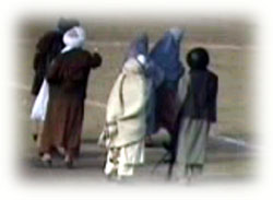 Taliban armed guards push her to the center of soccer ground for execution.