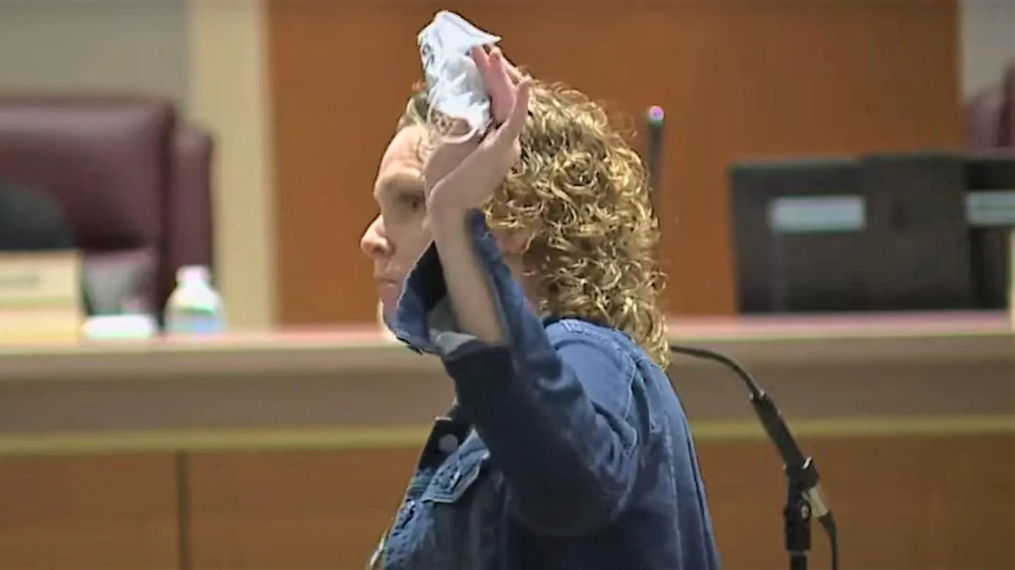 WATCH: School board meeting goes off the rails after woman tells everyone to rip off their face masks