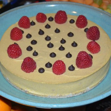 "Pumpkin ""Cheese"" cake decorated with raspberries and chocolate chips"