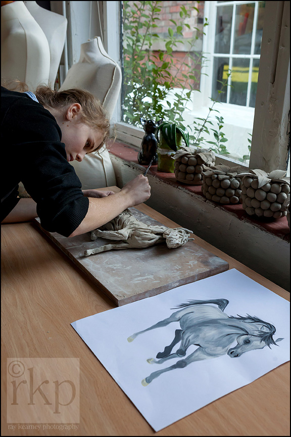Cransley school art class pupil working on clay model of a horse