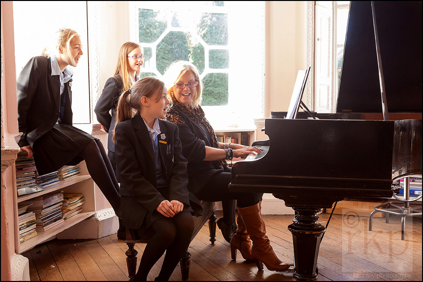 Cransley school pupils singing with teacher at the piano