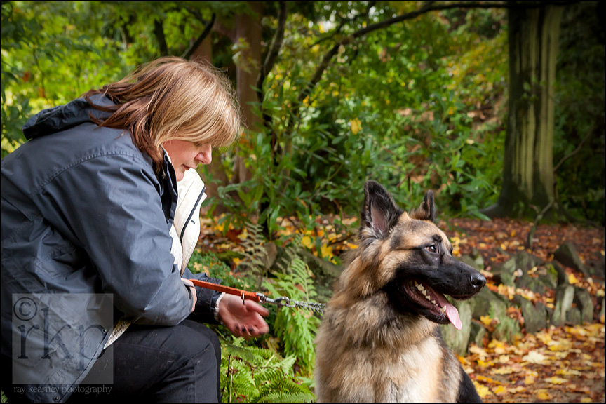 German Shepherd and owner having a quiet moment in Denzell Gardens, Altrincham by Ray Kearney Photography