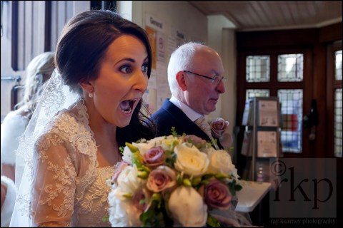 Bride sees friends at St Vincent's church, Altrincham