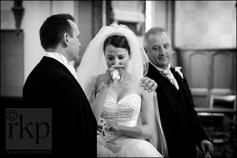 Bride's father reaches out during ceremony at Timperley Parish church