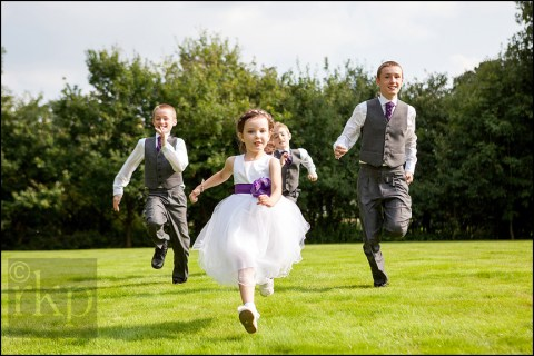 Flower girl and page boys running at Bartle Hall