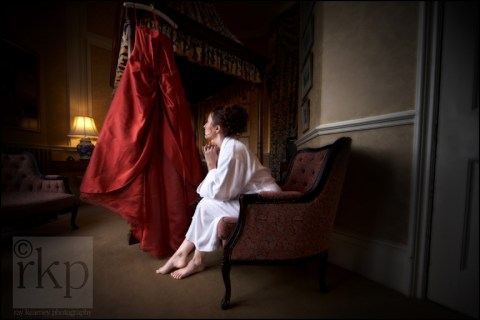 Bride looking at wedding dress at Crewe Hall