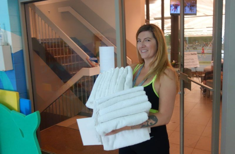 Raymi appears with fresh towels for the Saltwater Selfie participants