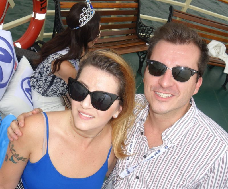Raymi with Ryan Weswaldi in front of Velago Sofa Selfie attraction on Oriole cruise ship