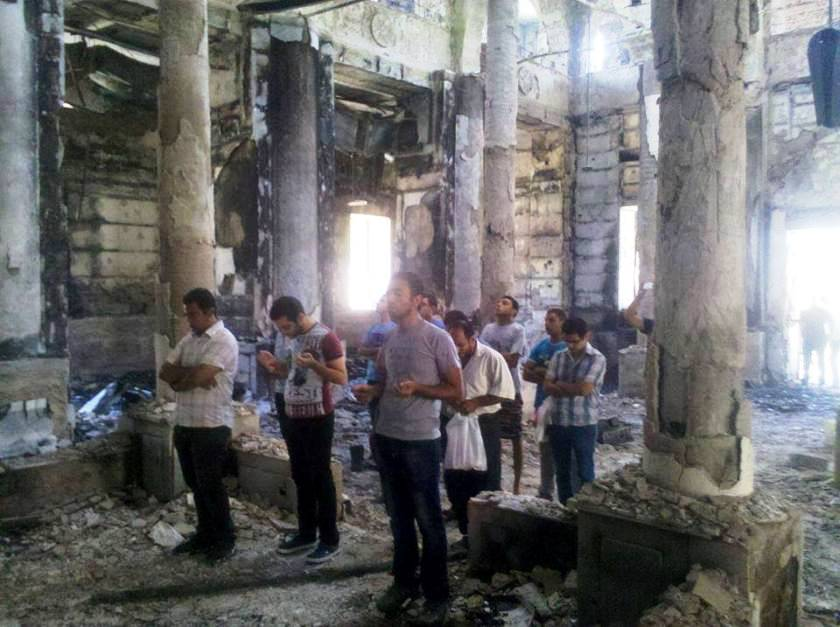 https://i0.wp.com/www.raymondibrahim.com/wp-content/uploads/2013/09/copts-pray-in-burned-church.jpg