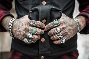 Hands with tattoo and rings