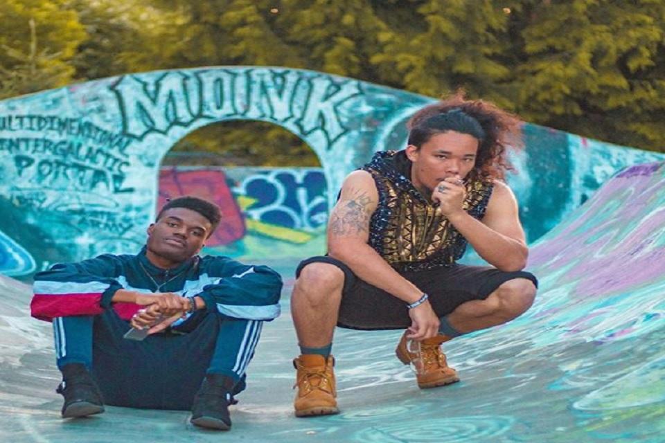 Nobi and Topp pose in graffiti covered skate park.