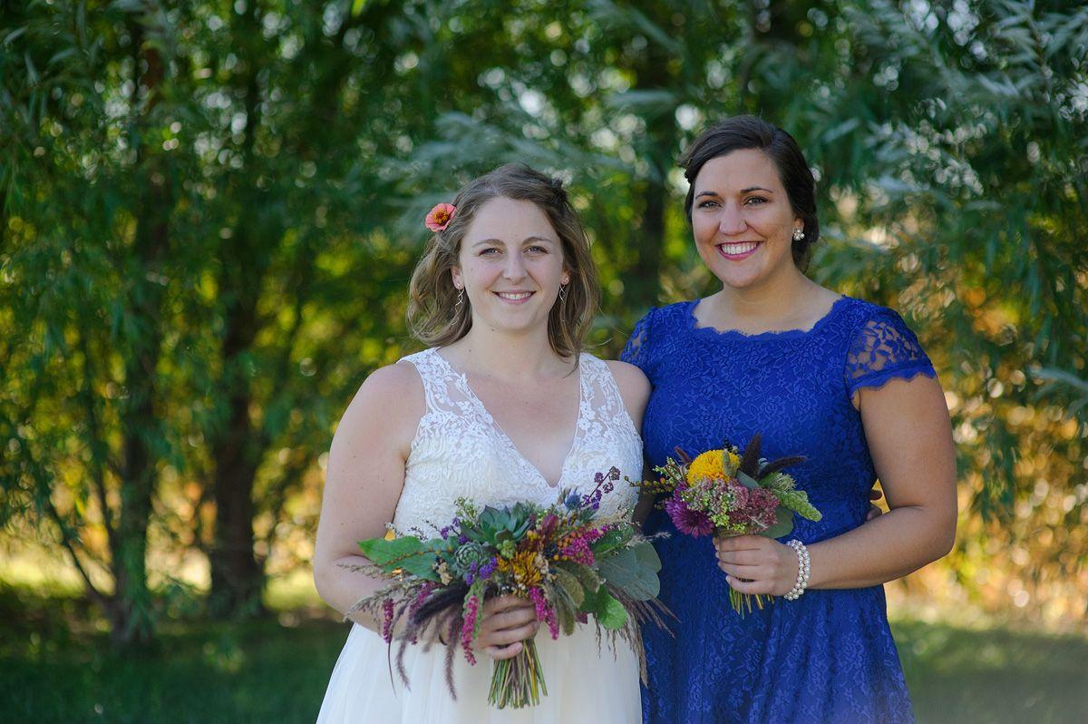 sutliff cider wedding - bride and bridesmaid