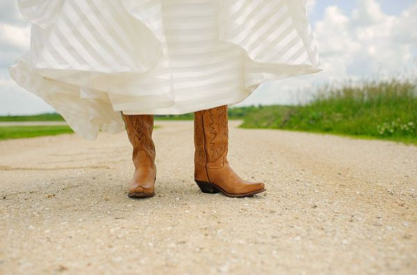 Bride with cowboy wedding boots