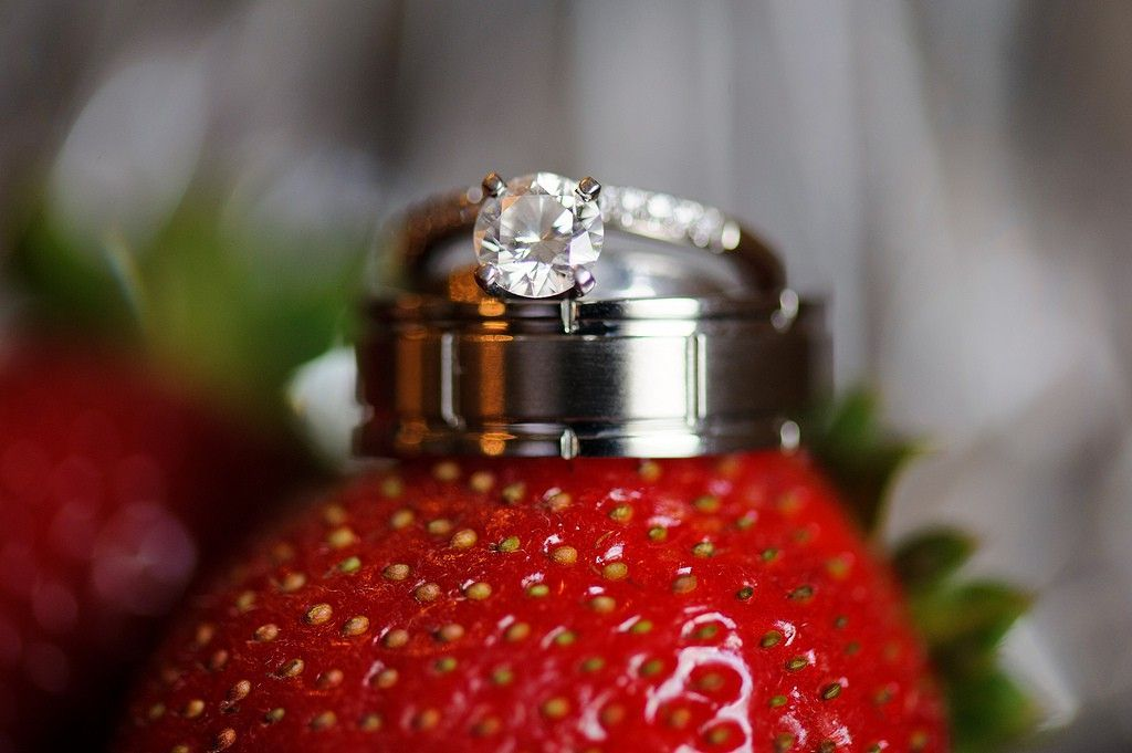 closeup of a wedding ring on strawberry