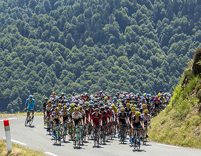 Col D'Aspin,France- July 15,2015: The peloton climbing the road to Col D'Aspin in Pyrenees Mountains during the stage 11 of Le Tour de France 2015.