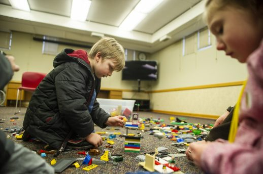 Max Muzzey, 5, of riverside, builds with Legos on Saturday, Jan. 25, 2020, during a LegoPalooza event in the children's section at the Riverside Public Library. | ALEX ROGALS/Staff Photographer