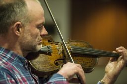 Alistair McCulloch plays a tune on the 267-year-old Gregg Violin, one of Scotland's national treasures, believed to have been played by that nation's national bard, Robert Burns, during a special concert at Caledonia Senior Living in North Riverside on Jan. 29. (Alex Rogals | Staff Photographer)