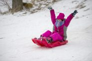 Charlotte Bavone, 7, of Riverside, goes sledding on Saturday, Feb. 15, 2020, at the Swan Pond hill in Riverside.