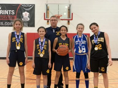 """""""Team Fierce"""" poses with its medals that it won at the regional round of the JR NBA three on three tournament (James Kay/Sports Editor)."""