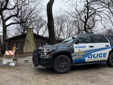 For the time being, residents should get used to seeing police vehicles parked outside S.E, Gross Middle School in Brookfield and the Scout Cabin in Riverside (above). | Bob Uphues/Editor