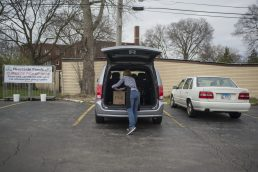 Workers load up customers vehicles with groceries on April 6, 2020, at Riverside Foods on Burlington Street in Riverside. (Alex Rogals/Staff Photographer)