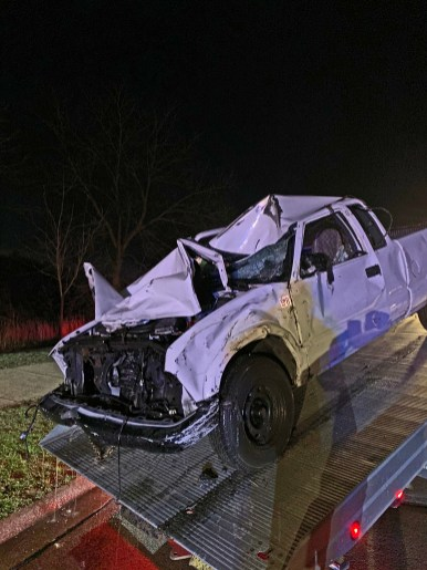 A 2003 Chevy pickup that left the roadway at Riverside and Olmsted roads in Riverside on April 9 landed on its driver's side in the Des Plaines River. The driver is in critical condition at MacNeal Hospital | Photo courtesy of the Riverside Fire Department