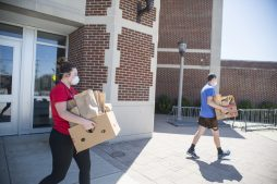 Lidia Bielobradek, left, brings out the excess packed lunches to load up in her vehicle to bring to Maywood's Housing Forward on April 20, at Riverside Brookfield High School. | ALEX ROGALS/Staff Photographer