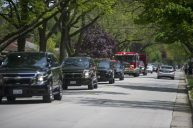 A caravan of police cars and fire engine start the parade for Maxx Kusper on May 16, at the corner of Washington and Arden Avenues in Brookfield. (Alex Rogals/Staff Photographer)