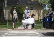 Families line up as a parade goes by for Maxx Kusper on May 16, at the corner of Washington and Arden Avenues in Brookfield. (Alex Rogals/Staff Photographer)