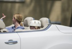 Maxx Kusper (wearing helmet) rides next to his mom, Marcey Raymond Kusper, past cheering well-wishers lined up on the streets to welcome the boy home from the hospital on May 16. (Alex Rogals/Staff Photographer)