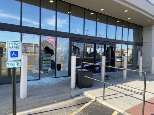 Looters forced their way past the security gate and broke out other windows to gain entry to Binny's Beverage Depot in North Riverside on May 31. | Bob Uphues/Editor