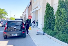 People run from Kohl's, 2200 Cermak Road, after looters broke into both entrances on May 31 and stole merchandise from the store. (Bob Uphues/Editor)