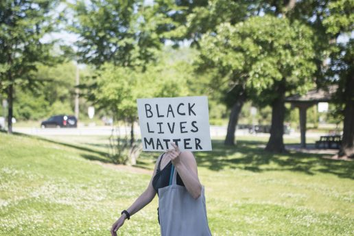 Demonstrators carry signs on Saturday, June 6, 2020, during a Black Lives Matter protest at Kiwanis Park in Brookfield. | ALEX ROGALS/Staff Photographer