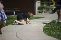 Protesters use chalk to write on the sidewalks on Saturday, June 6, 2020, during a Black Lives Matter protest at Kiwanis Park in Brookfield. | ALEX ROGALS/Staff Photographer