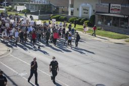 About 200 demonstrators approach Maple Avenue as they march down Ogden Avenue in Brookfield on June 11. | Alex Rogals/Staff Photographer