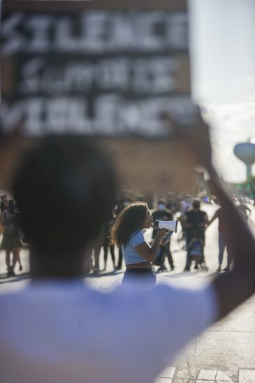 Destiny Hurd speaks to fellow demonstrators at Ogden and Maple in Brookfield at the end of their march for justice on June 11 | Alex Rogals/Staff Photographer