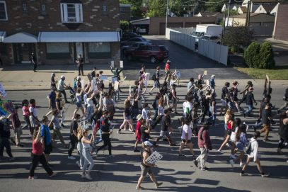 Demonstrators approach Maple Avenue as they march down Ogden Avenue in Brookfield on June 11. | Alex Rogals/Staff Photographer