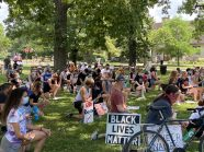 Demonstrators kneel silently in Guthrie Park in Riverside in memory of George Floyd and other Black victims of police violence during the June 19 rally for racial justice.   Bob Uphues/Editor
