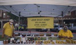 John Bailey, left, and Steve Bohan, sell honey on Wednesday, June 24, 2020, during the Riverside Farmers Market. (Alex Rogals/Staff Photographer)