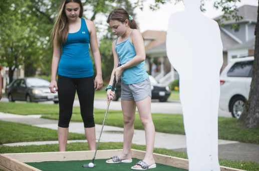 Sienna Giampietro, 10, plays on Sunday, June 28, 2020, during Brook Park Council Summer Camp Progressive Putt Putt throughout Riverside and Brookfield. (Alex Rogals/Staff Photographer)