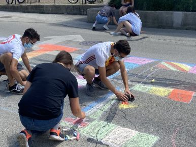 About 20 young adults turned out in downtown Riverside on July 12 to chalk a mural on Pine Avenue in support of Black Lives Matter. Someone attempted to deface it by dumping water on a portion of it overnight, according to local officials, but it remained largely intact on Monday. (Bob Uphues/Editor)